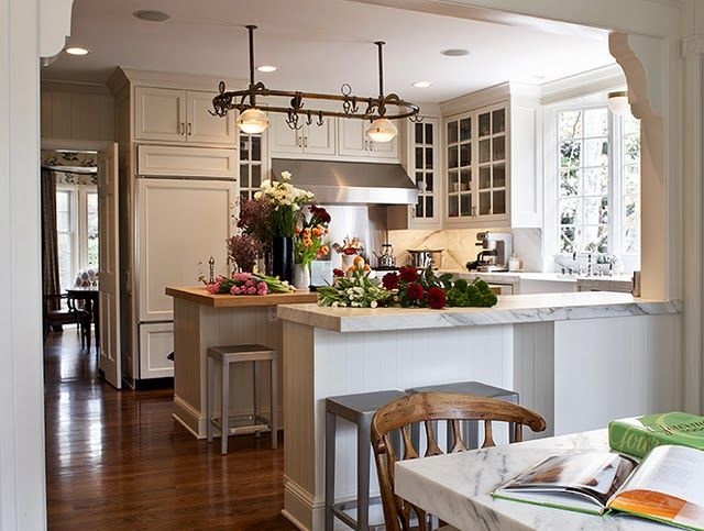 small kitchen. white cabinets. marble countertops. beautiful.