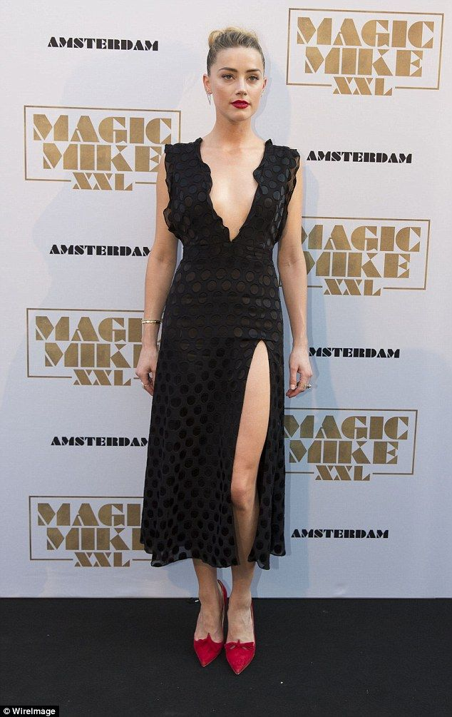 Consistently chic: Amber has been impressing at the various promo events for the film - her red carpet moment at the Amsterdam premiere on Wednesday was racy yet elegant in a plunging, thigh slit black dress