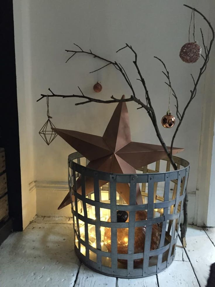 Rustic see through basket dressed with gift packages, star, white birch branches.