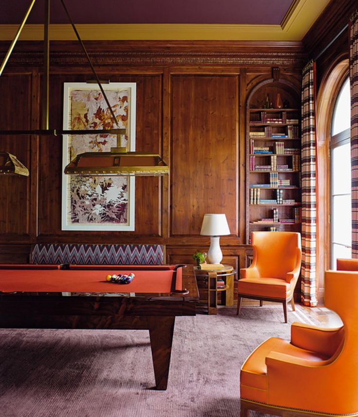 The eggplant hued purple is subtle. Here the vibrant orange adds a bolt of excitement to the billiard's interior design. Steven Gambrel's 'Time And Place' Depicts Evolving Yet Timeless Design
