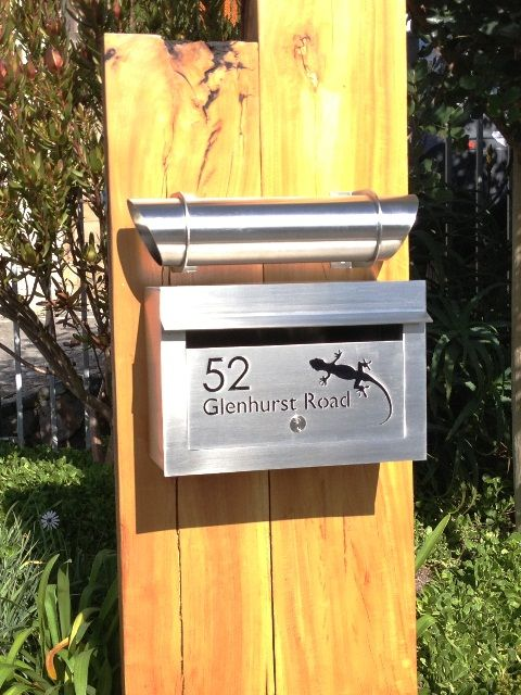 External Landscape Stainless Steel Letterbox with cut-out text in the door panel and backed with black perspex. Supplied with a separate News Paper Tube. Grade 316 stainless steel with brushed finish.