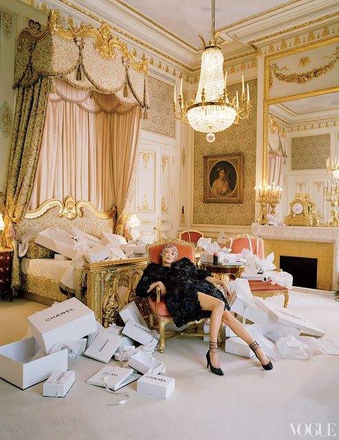 Kate Moss wearing Chanel haute couture in the Chanel suite at the Ritz, Paris. Coco Chanel kept a suite at the hotel for 35 years around the corner from her salon on Rue Cambon.