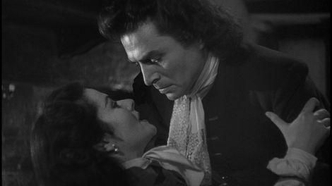 """The real """"Highwayman"""" Jerry Jackson (James Mason) brings his impersonator Barbara (Margaret Lockwood) into a criminal's pub in a torrid scene from <B>The Wicked Lady</B> 1945."""