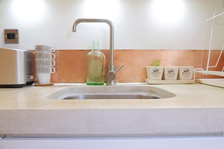 My Kitchen. Copper Splashback and concrete worktop.