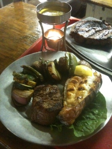 Enjoy fine dining in a rustic log cabin situated on Route 66 along the Verdigris River at Molly's Landing in Catoosa.