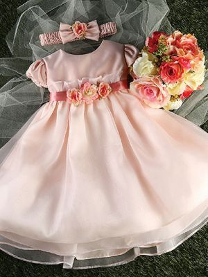 Adorable and simply sweet, your precious little one will look absolutely angelic in this classic and elegant dress. Made from luxurious satin fabric, this pretty gown is styled with charming gathered