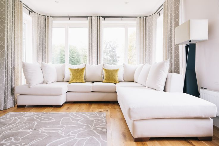 Bespoke corner unit sofa. Designed to seat a minimum of four and use the full space of a large open bay section of the rear elevation