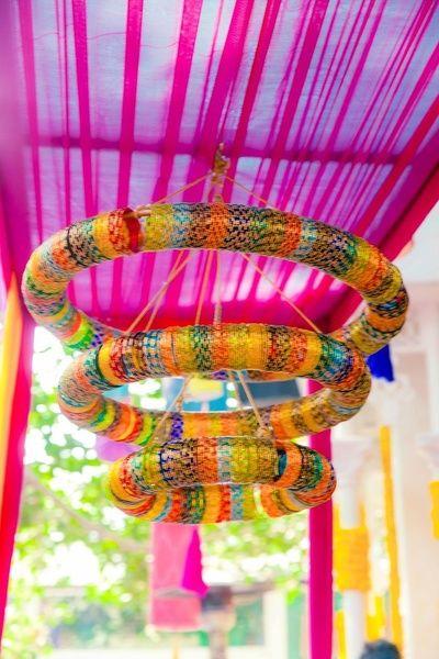 Mehendi Wedding Decor - Best Wedding Decor Ideas: Browse Mehendi, Sangeet and Wedding decor Multi coloures bangles chandelier