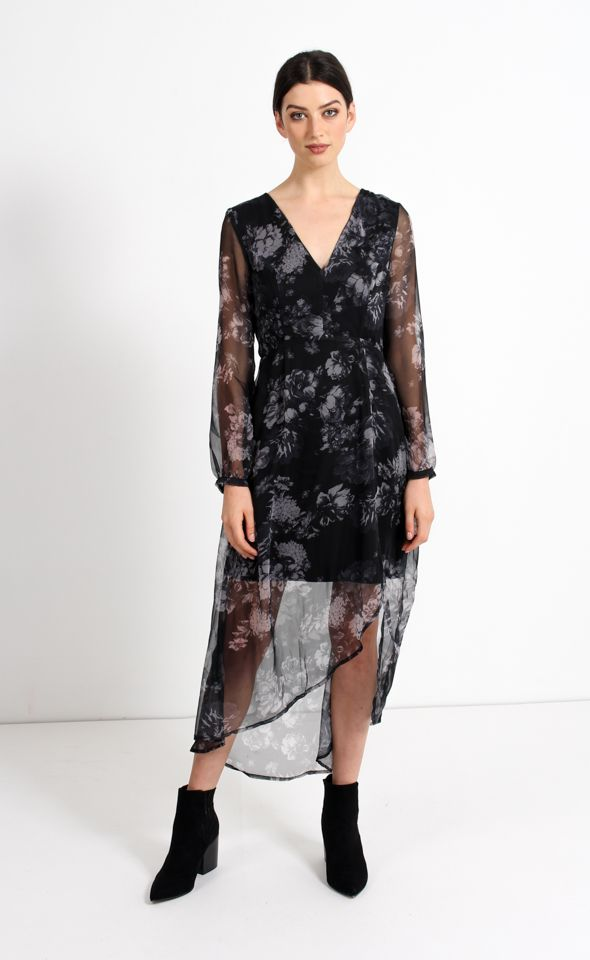 Floaty and fun, this dress is sure to make a statement. Designed with sheer long sleeves, this piece is perfect for the cooler days. The detailed crossover back adds further shaping to this dress for a flattering silhouette.