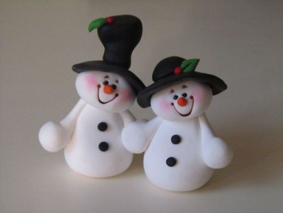 I individually handcraft each of my items out of polymer clay. No molds are used. This snow couple stands approximately 3 high. They are permanently joined.