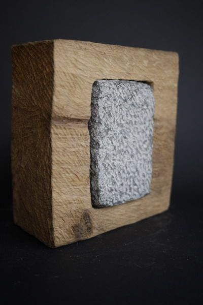 Complimentary texture: the stone within the wooden rectangle has a texture that is complimentary to that of the wood.