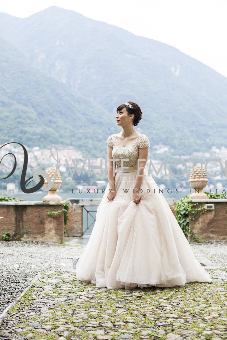 an #elegant #bride in #aimeespose wedding dress on the shores of #romantic #lakecomo on a #summer #wedding.