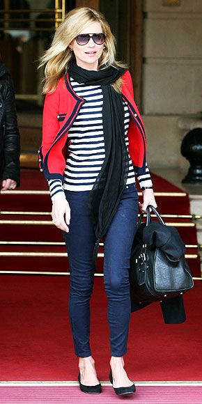Kate Moss is Parisian chic in her striped top and dark jeans paired with a gold-buttoned red blazer and aviator shades.