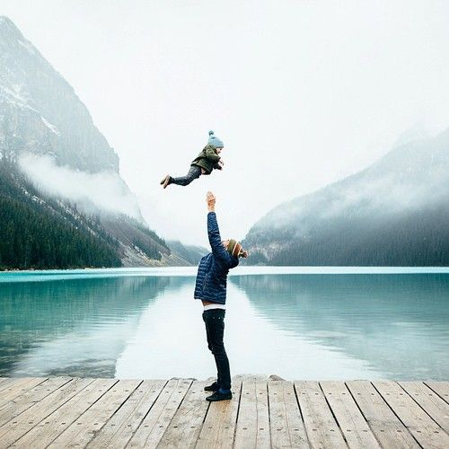Moment: Unrehearsed. This is unrehearsed because the dad has not thrown the little boy before and they have never practiced it. The picture has reflections in the lake in the background