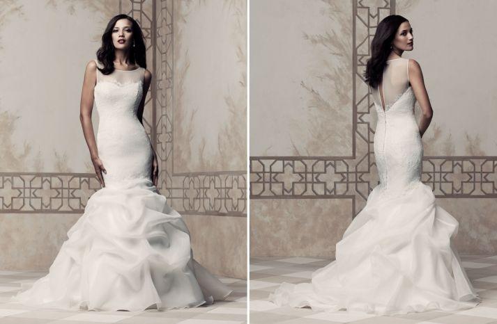 Illusion neckline and back top of this dreamy mermaid Paloma Blanca #wedding dress.