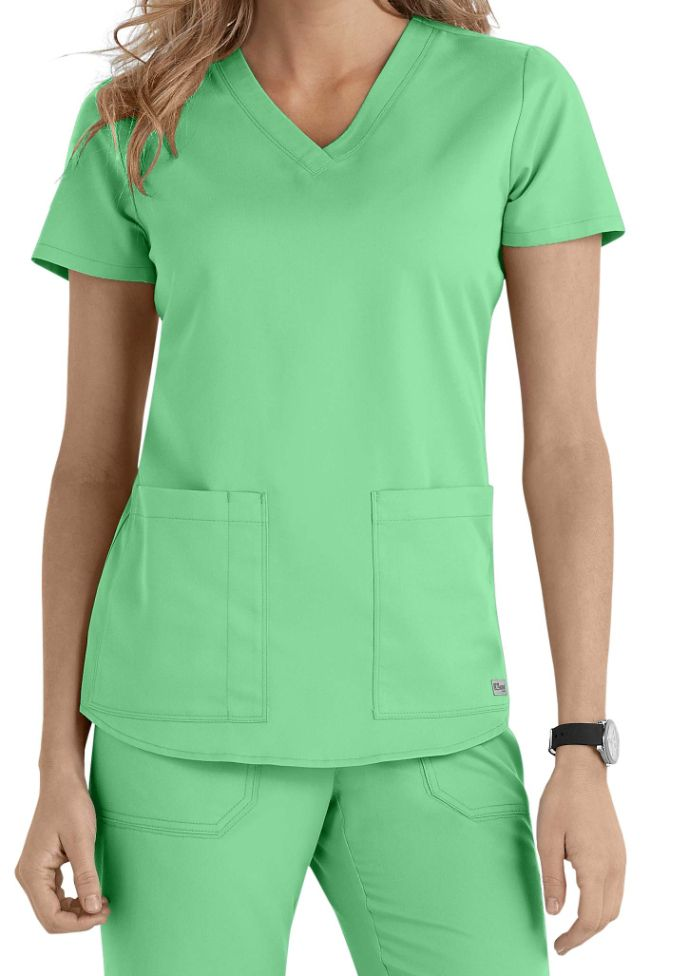 This graceful v-neck top (in Honey Dew) from Grey's Anatomy is a perennial top seller! The flattering fit and roomy pockets will make it an essential part of your work week attire!
