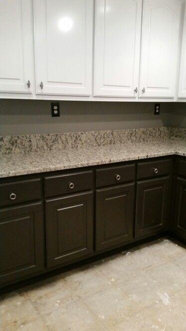 "Sherwin Williams ""sealskin"" dark grey paint on bottom kitchen cabinets with ""New Venetian Light"" granite"
