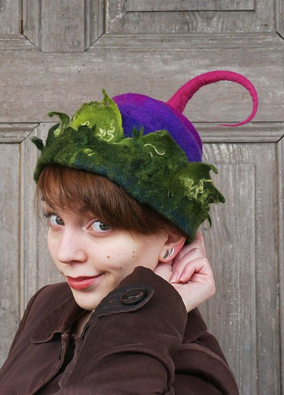 Beautiful hand felted pixie hat with tip and double brim like crown, woodland fairy hat, one of a kind, purple with green leaves . You can wear it in different ways! Its made of merino wool and decorated with wool curls and hand-shaped. Light and elegant! Good for any time of year, it can be an excellent complement to the original outfit for special occasions like festivals or concerts.  Head circumference - ca 54 cm (21 inches)