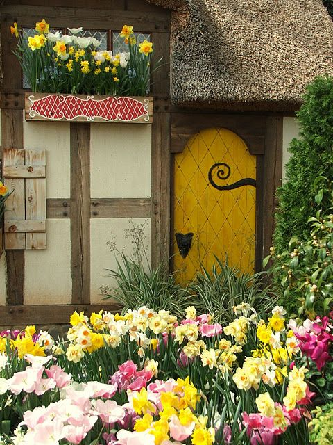 A cottage nestled in bright spring flowers in the Ginter Botanical Gardens in Richmond, Virginia  (via No Minimalist Here: Celebrating 1st Day Of Spring)