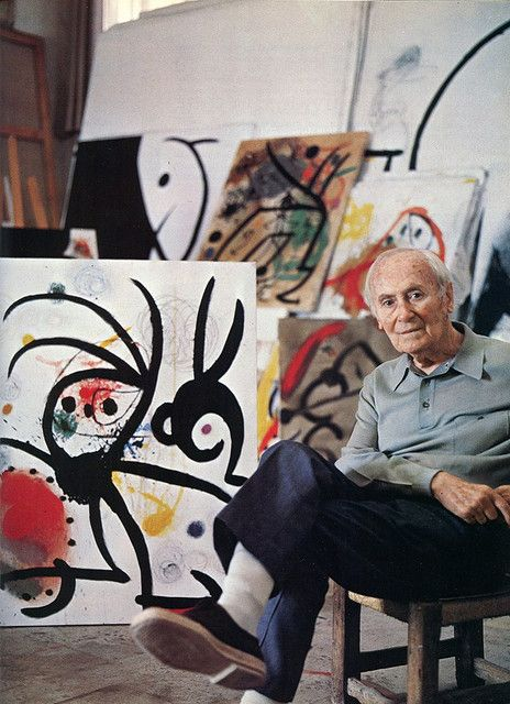 Artist Joan Miro among his work.