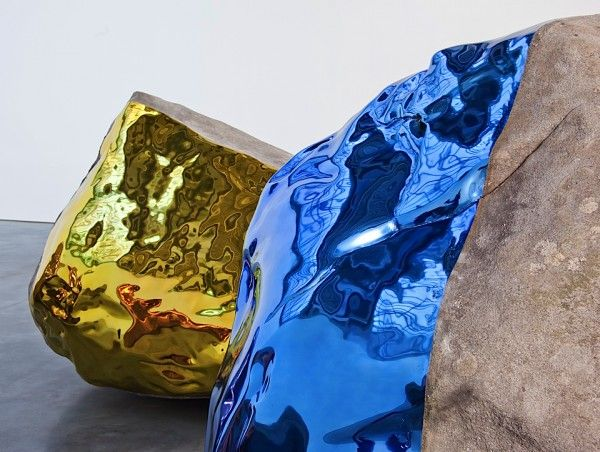 Sculptor Jim Hodges (1957) created a compelling installation at Barbara Gladstone's21st St. location in NY, grouping 4 large scale boulders around a central void. Hodges replaced part of the original surface of the rock with vibrantly colored stainless steel casts offs.
