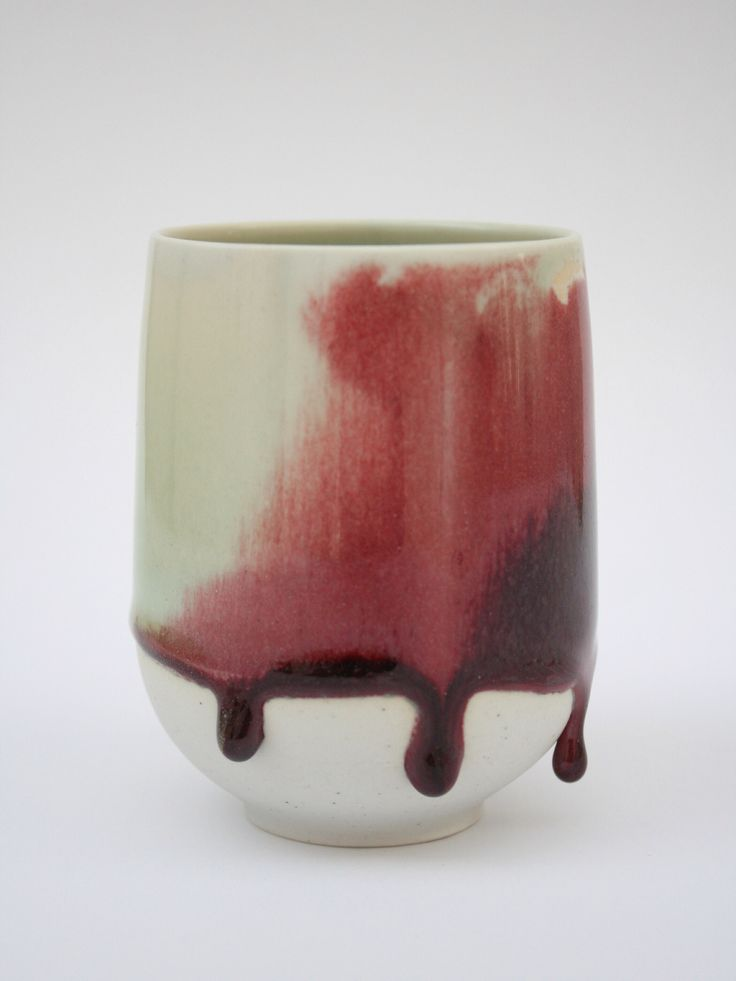 Thrown cup with two different glazes, oxblood and blue/green glaze.