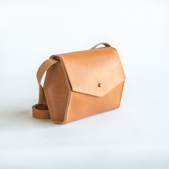 Mini crossbody with a solid brass button stud closure and tall hexagonal side panels. Available in natural and black. - Full grain, USA tanned leather -