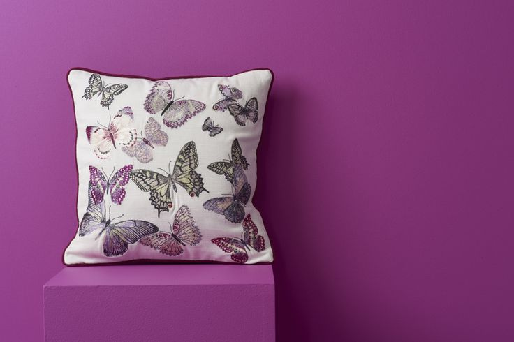 Perk up your sofa with a charming butterfly-print cushion.