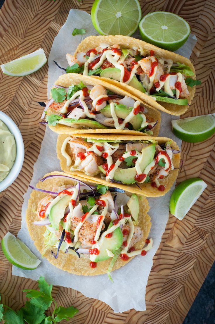 Easy baked fish tacos recipe. The sauce is easy prepare, the fish is easy cook and the toppings are easy to cut up... why not try these delicious fish tacos at home? Your guests will be so impressed!    #bakedfishtacos #fishtacos #fishtacorecipes #fishtacorecipe #fishtacosauce #mexicanfood #snappertacos #tacos #taco #redsnapper