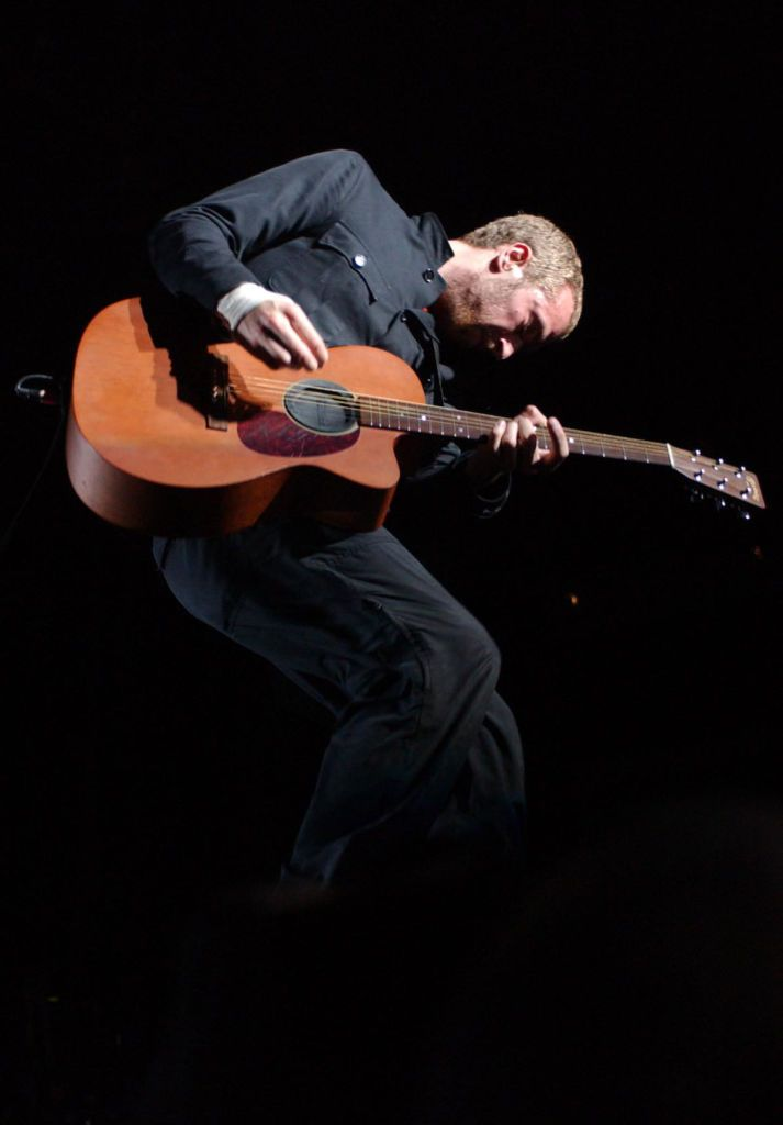 Chris Martin Lead Singer Of Rock Band Coldplay Performing Live At