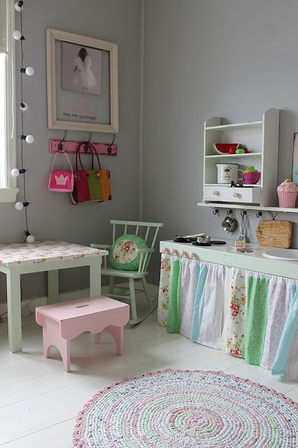 DIY Play Kitchen. Maybe I could make this out of an Ikea table? Just add fabric, sink and stove buttons. For Lorelei's room.