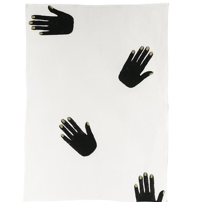 Off white linen tea towel with black hand prints with metallic nails
