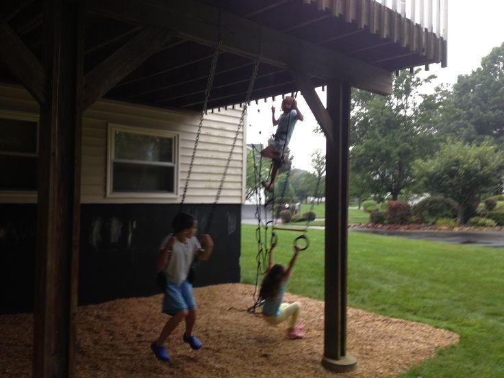 DIY under the deck playground, swings, climbing net, chalkboard, playhouse