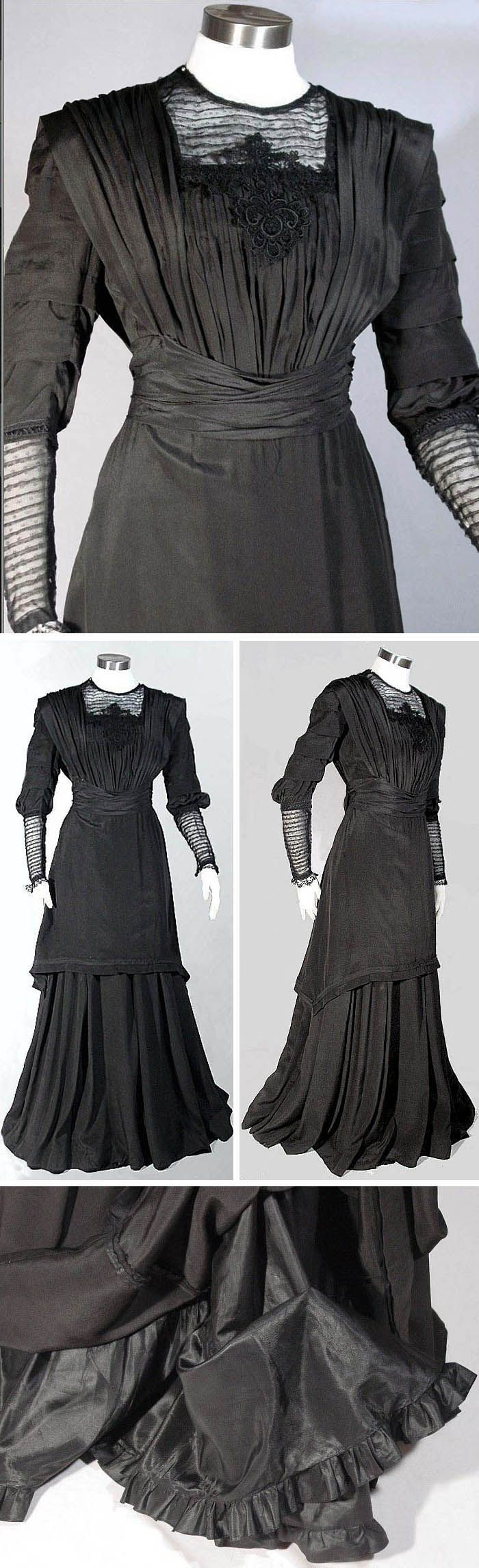Day dress, ca. 1910. Black silk (cross between jersey and crepe), slightly elevated waistline. Tunic-style bodice with black embroidered net lace  above bust and on lower sleeves. Wide cummerbund at waist that narrows & hooks in back. Two-layer skirt, with underlayer being Princess-cut with 2 deep flounces under it at bottom of lining. Ruby Lane Vintage