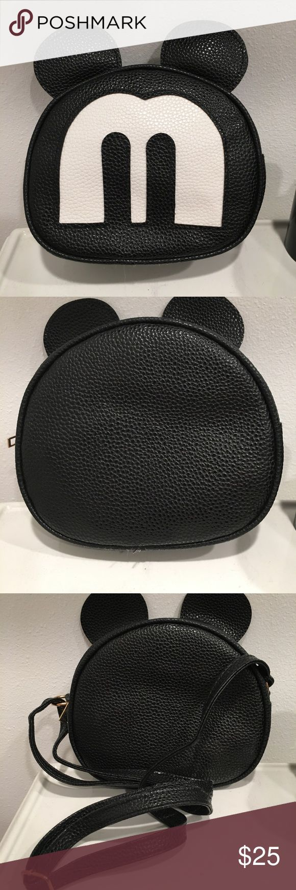 """New Mickey Mouse Crossbody Bag Brand New Never Carried. Black Man Made Leather and PVC Trim. Adjustable Strap Drop 12"""" to 28"""". Bag is 6"""" across and 3"""" deep. Fits an IPhone 6s.  Imported from China. Bags Crossbody Bags"""