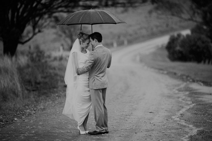 Wet weather wedding photo. Bistro Molines Hunter Valley wedding. Image: Cavanagh Photography http://cavanaghphotography.com.au
