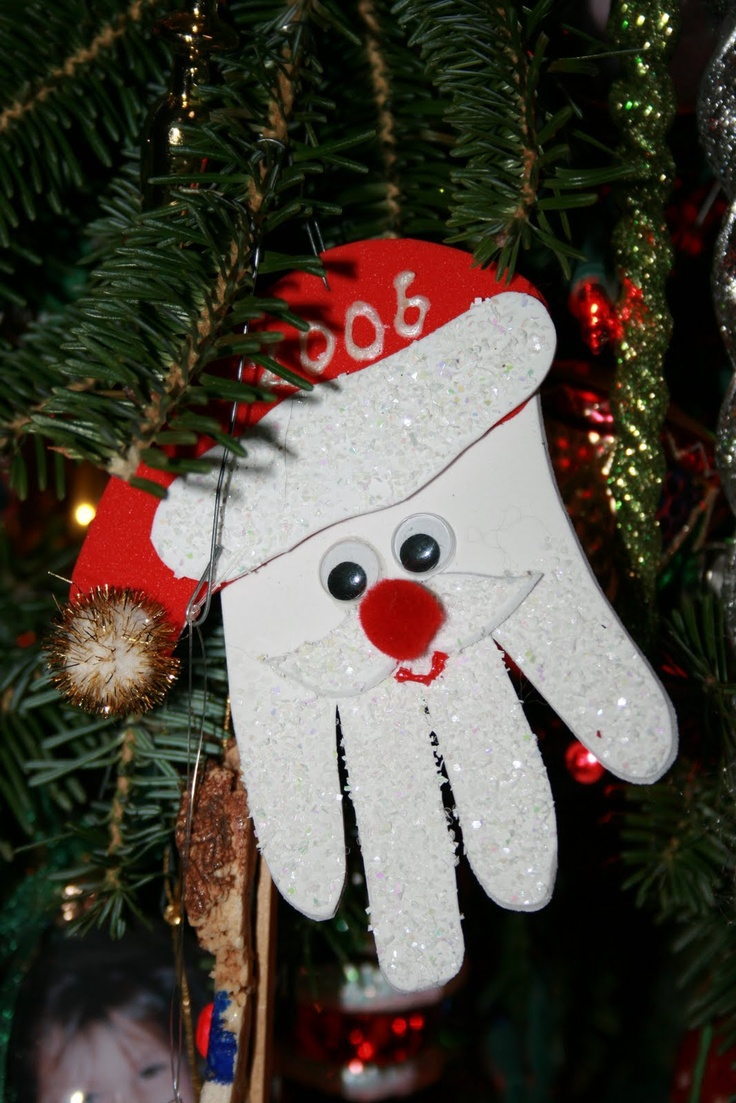 We are making these for Lucilynn's school Christmas Party!!! =D  Santa Handprint Ornament