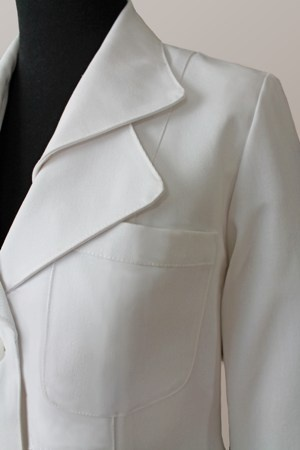 "A lab coat for the fashion-obsessed, the ""Iris"" stands out in unique style."