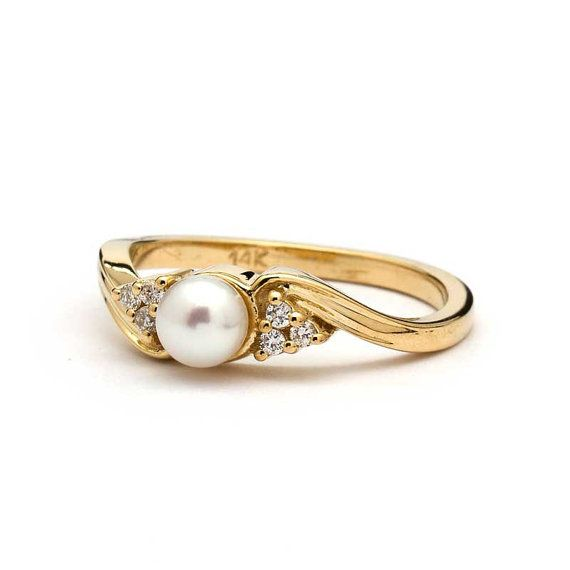Hey, I found this really awesome Etsy listing at https://www.etsy.com/listing/240498863/vintage-pearl-engagement-ring-in-yellow