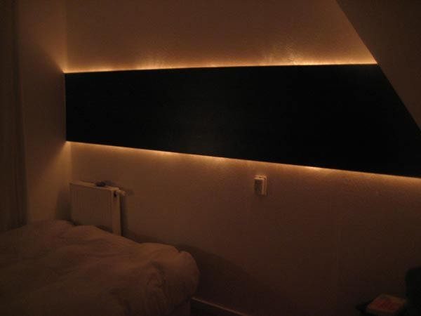 Very cool project using rope lights and a few planks of laminate flooring mounted on the wall.