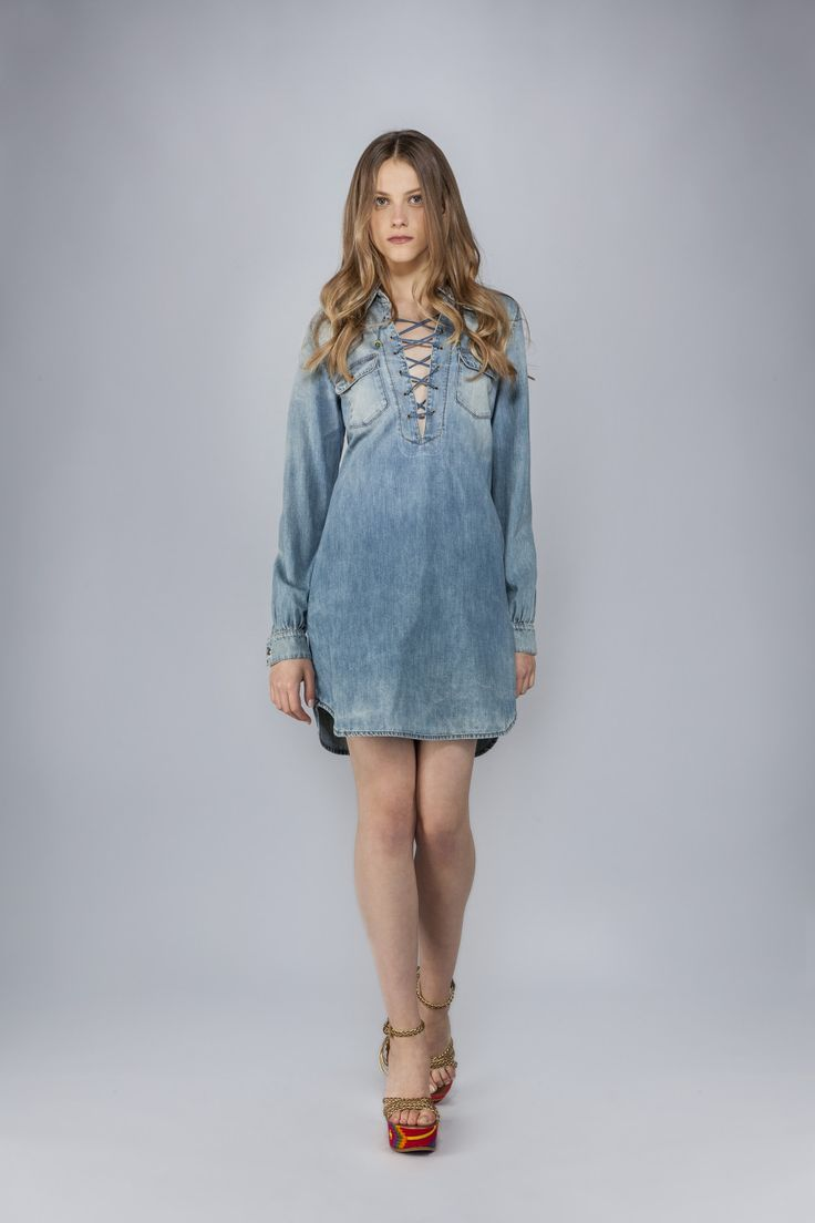 Denim mini dress with criss-cross detail, stretch denim.<br>Made in Italy<br>The model's measurements are:<br>Height 173cm, Bust 84cm, Waist 60cm, Hips 85cm which generally refers to a size 40