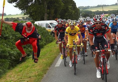 The Tour de France is on my wish list...don't know why, I don't follow cycling except for this one race each year.  Check out the man in the devil costume on the left.  I love watching the characters that show up to cheer on the cyclist.  Hum, what would I wear....?