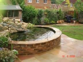 raised brick pond with higher rock waterfall