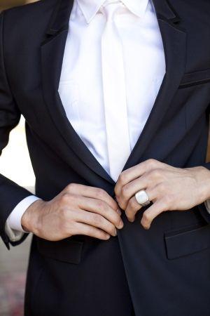 groom wearing ring