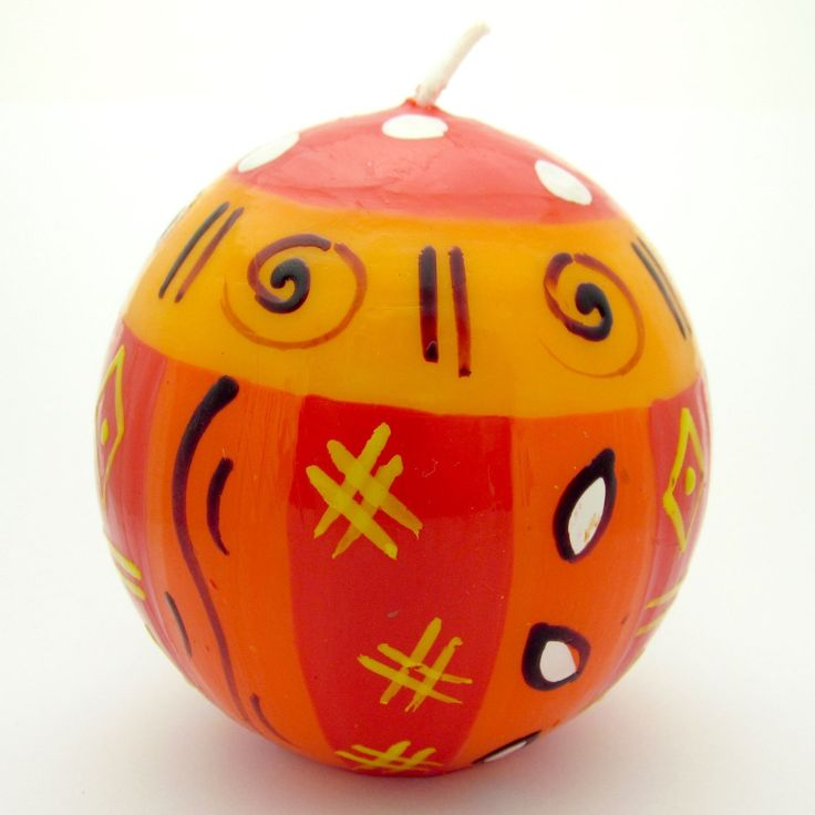 This colorful candle features a spherical shape, which is hand-painted by artisans in South Africa. Each candle is 3 inches in diameter.