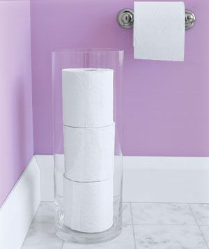 Vase as Toilet Paper Storage - The perfect arrangement for helping toilet paper hide in plain sight. Guests don't have to root around for a new roll in your not absolutely, positively tidy vanity, and you always know when you're running low.