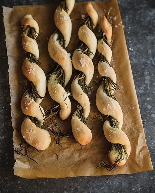 A really fun way to make grissini. You are not supposed to eat the rosemary sprigs, you simply pull off the bread and enjoy! Small bits of the rosemary will stick to the bread and make it even more delicious.