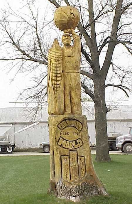 Tree trunk carvings farmers feed the world location in