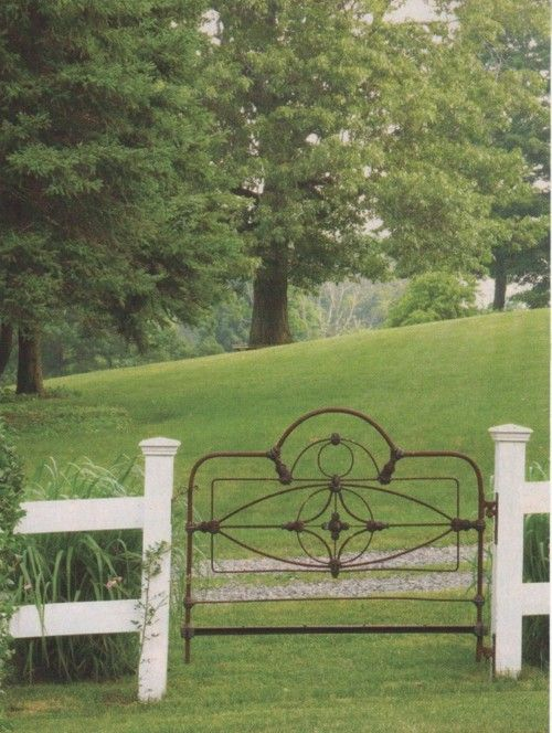 iron headboard that is now a beautiful gate