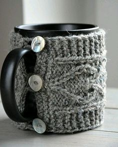 Grey wool coffee cup warmer with cable pattern and coral buttons.  Have a nice morning!  Many cozies avaible in my etsy shop. Link in bio. Worldwide shipping! Perfect for #christmasgift  #morningpeople #mornings #morningcoffee #handmade #cupcozy #cupofcoffee #cupwarmer #mugwarmer #coffeesleeve #mugcozy #hotcoffee #tasse #tassenwärmer #knittingismyyoga #knittersofinstagram